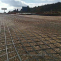 High Strength Steel-Plastic Geogrid Treatment of uneven settlement of soft soil roadbed