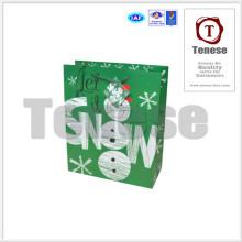 Bolsa de papel encantadora del abrigo del totalizador del muñeco de nieve con la etiqueta
