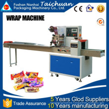 Automatic Top film loading rotary flow wrap machine hot selling in india