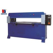 Auto-feeding hydraulic press cutting machine for clamshell