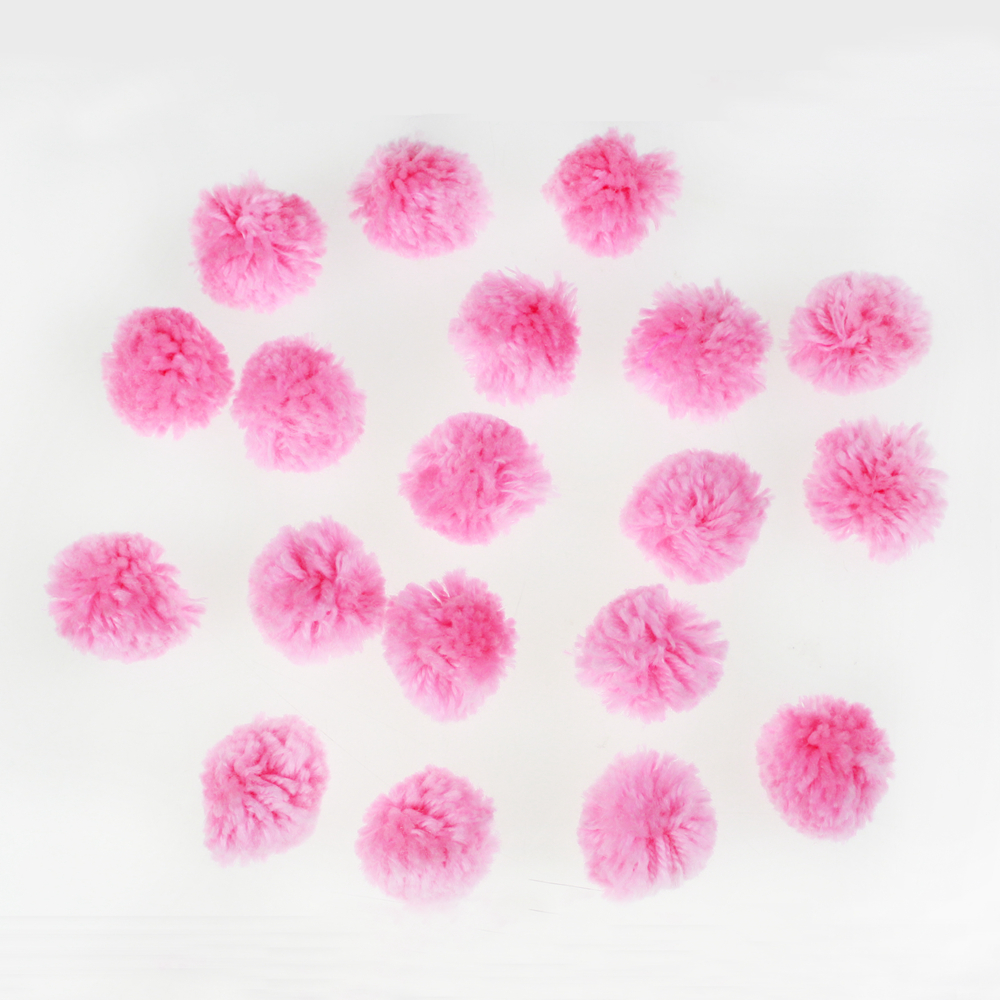 Pink yarn craft pompom ball