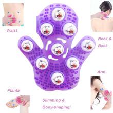 Boule en acier magique de Massager tenu dans la main amincissant des gants de massage