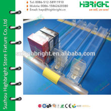 Shelf divider pusher and rail with price tag