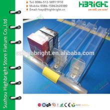 Empurrador e trilho do divisor de prateleira com etiqueta de preço