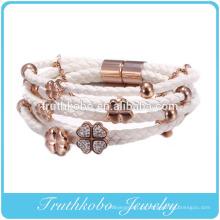 Novo design rosa de ouro de alta imitação de diamante de quatro folhas trevo pulseira corda pulseira de couro