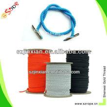 Cordón trenzado azul con punta de púas metálicas