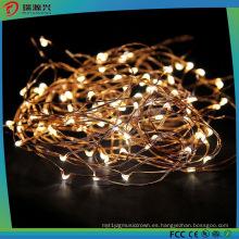 La cadena de alambre de cobre amarillo del color LED enciende L1013-008