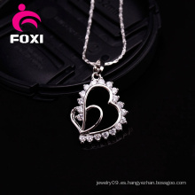 Encantos del colgante del oro del diseño simple de la forma del corazón