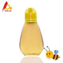 Miel pur d'acacia identique au miel cru