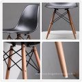 Popular PP plastic seat beech wood legs dining chairs cheap sale