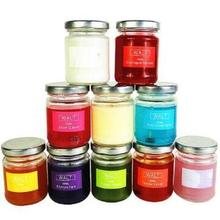Multi-colored scented candles in round glass jar