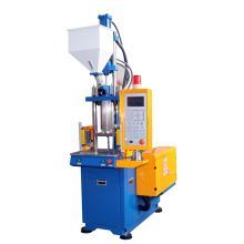 Small vertical injection molding machine