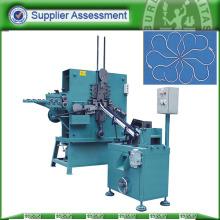 Machine de cintrage et de fabrication de crochets de suspension à fil rond