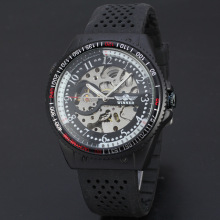 winner travel watch with visible mechanism silicone band