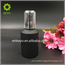 100ml black glass bottle with pump head cosmetic frosted bottle