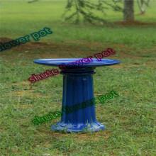 Blue pottery bird feeder for bird