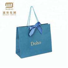 Pas cher prix luxe bleu clair et or transporteur ruban cravate cadeau shopping sacs en papier avec poignées