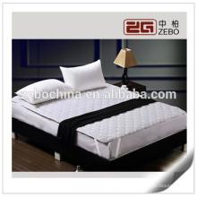 Venta caliente poliéster lavable al por mayor impermeable colchón protector