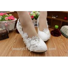 Los zapatos de las mujeres blancas altas y blancas y los zapatos de las señoras WS012