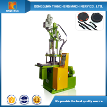 Sliding table vertical plastic making machine