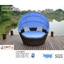 Outdoor leisure sex lounge chair with canopy.