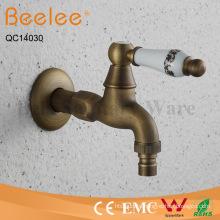 Antique Brass Ceramic Handle Bibcock Wall Mount Faucet