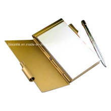 Metal Memo Pad titular con la pluma y el papel