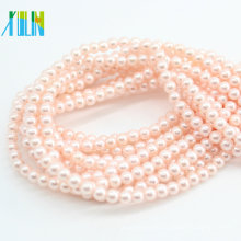 Al por mayor barato Oyster 4-10MM melocotón redondo perlas naturales de concha Perla suelta ostra