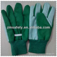 Gants de jardin en coton vert avec des pois pvc sur palmJRG01