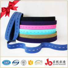 Woven elastic webbing with buttonhole ribbon tape