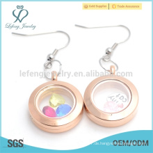 Flippige rosafarbene Gold-Ebene-Medaillon-Magnetmädchen schwimmende Medaillon-Ohrringe Großhandelspreis