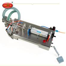 Una máquina semi automática de llenado de botellas de aceite de oliva líquida para la venta