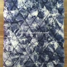 tecido térmico, diamante estofando da tela com um pano de malha