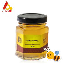 Miel de Chaste pur dans une bouteille de miel d'abeille