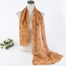 Les prix bon marchés imprimés en mousseline de polyester dames joyeux notes de musique modèle 100% écharpe en polyester