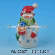 Funny ceramic candle holder with snowman design