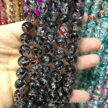 Kristallquarz 10mm rund rot mit schwarzen Mischfarben Knistern Schmuck Perlen