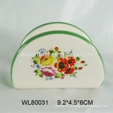 Sostenedor de la servilleta de la etiqueta de la flor llena de la cerámica