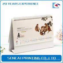 O melhor melhor calendário de parede popular do calendário da parte superior de tabela da forma do dobramento