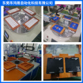 Rotary table screen printing machine with downloading device
