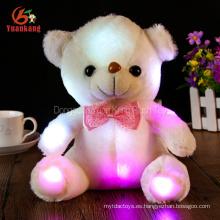 Venta al por mayor promocional de bajo precio resplandor Oscuro cumpleaños feliz felpa animal juguete eléctrico resplandor iluminar LED oso de peluche para niños