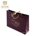 China Manufactures Großhandel Luxus gedruckt Goldfolie Logo Design Hochzeit benutzerdefinierte Papier Geschenktüte mit Griff