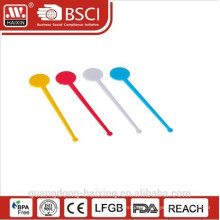 plastic stirring spoon
