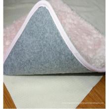 Camada de almofada antiderrapante para tapetes