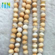 TB004 XULIN Großhandel 6mm Natürliche Glatte Facettierte Multicolor Gelbes Blut Sea Shell Lose Edelstein Perlen