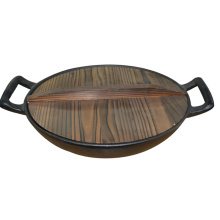 cast iron wok with vegetable oil coating