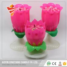 Velas de cumpleaños rotativas musicales de la flor de loto