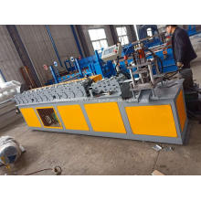 Machine de production de porte de volet roulant
