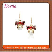 Red crystal bowknot and small pearl dangle earring plated 18k gold