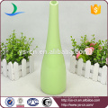 green cylinder glazed ceramic bud vase